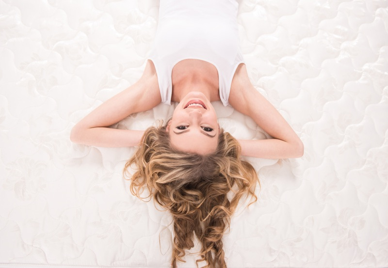 Model Laying on Mattress