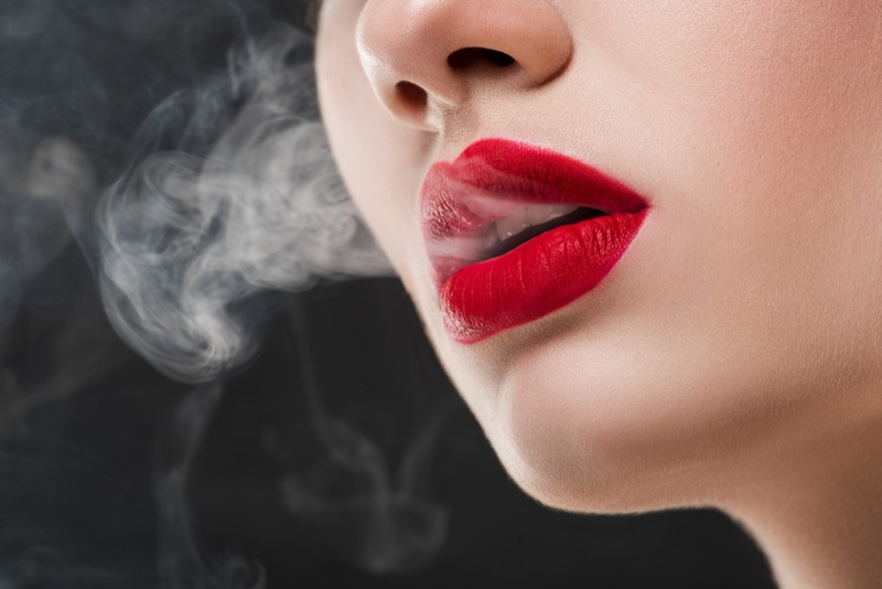 Model with Red Lips and Smoke