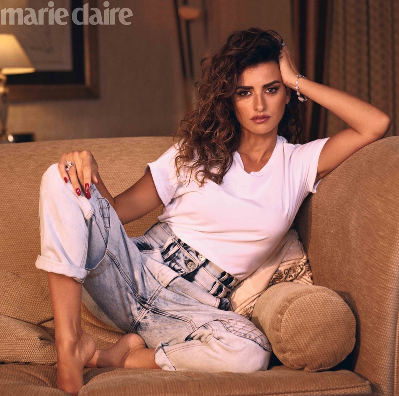 Actress Penelope Cruz wears Balmain t-shirt and jeans