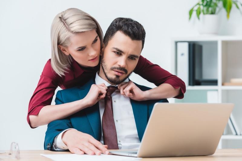 Woman Adjust Man's Tie
