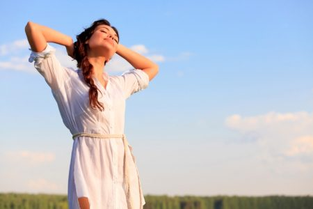 Woman Posing in Field and Happy