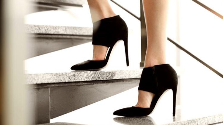 Woman Wearing Black Heels on Staircase