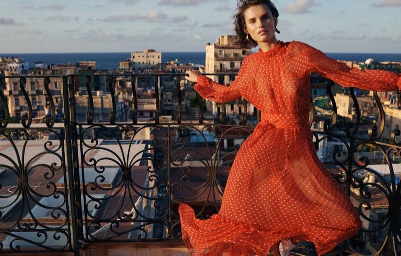Giedre Dukauskaite poses in Zimmermann Ninety-Six swing dress featuring polka dots
