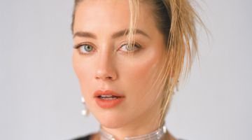 Getting her closeup, Amber Heard poses in sparkling jewelry