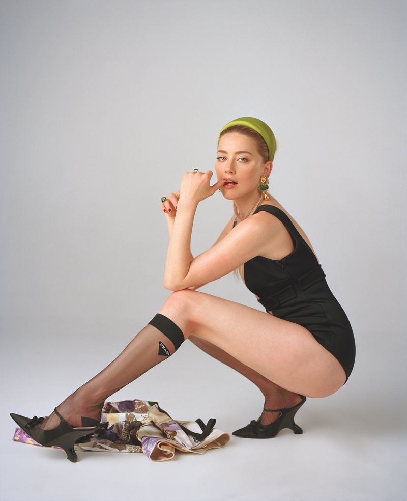 Actress Amber Heard wears black bodysuit with Prada stockings