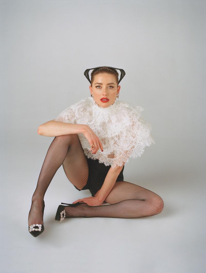 Amber Heard poses in Vera Wang top with Roger Vivier heels