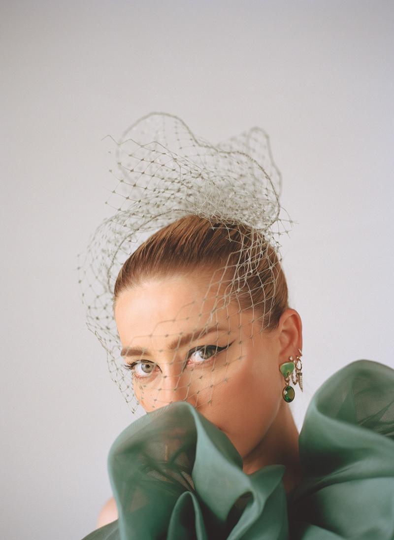 Looking elegant, Amber Heard poses in mesh veil with ruffled design