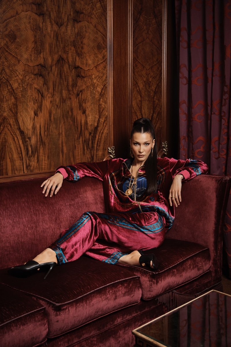 Bella Hadid wears burgundy tracksuit in Kith x Versace campaign
