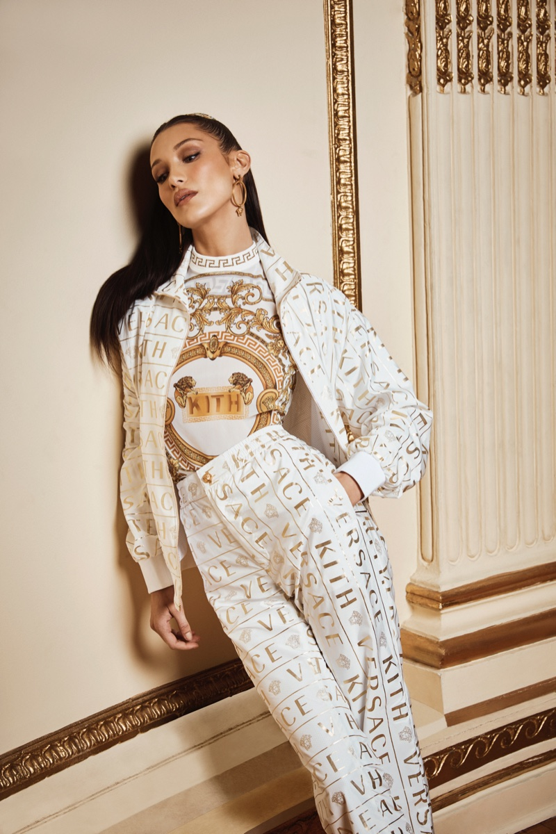 Bella Hadid poses in a logo print from the Kith x Versace collaboration
