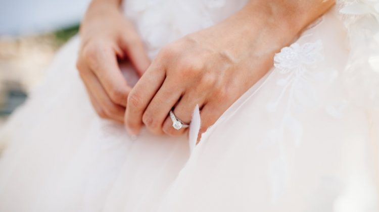 Bride Wearing Engagement Ring in Wedding Dress