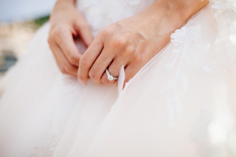 Bride Wearing Engagement Ring in Wedding Dress