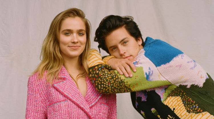 Haley Lu Richardson poses in pink jacket look while modeling alongside Cole Sprouse