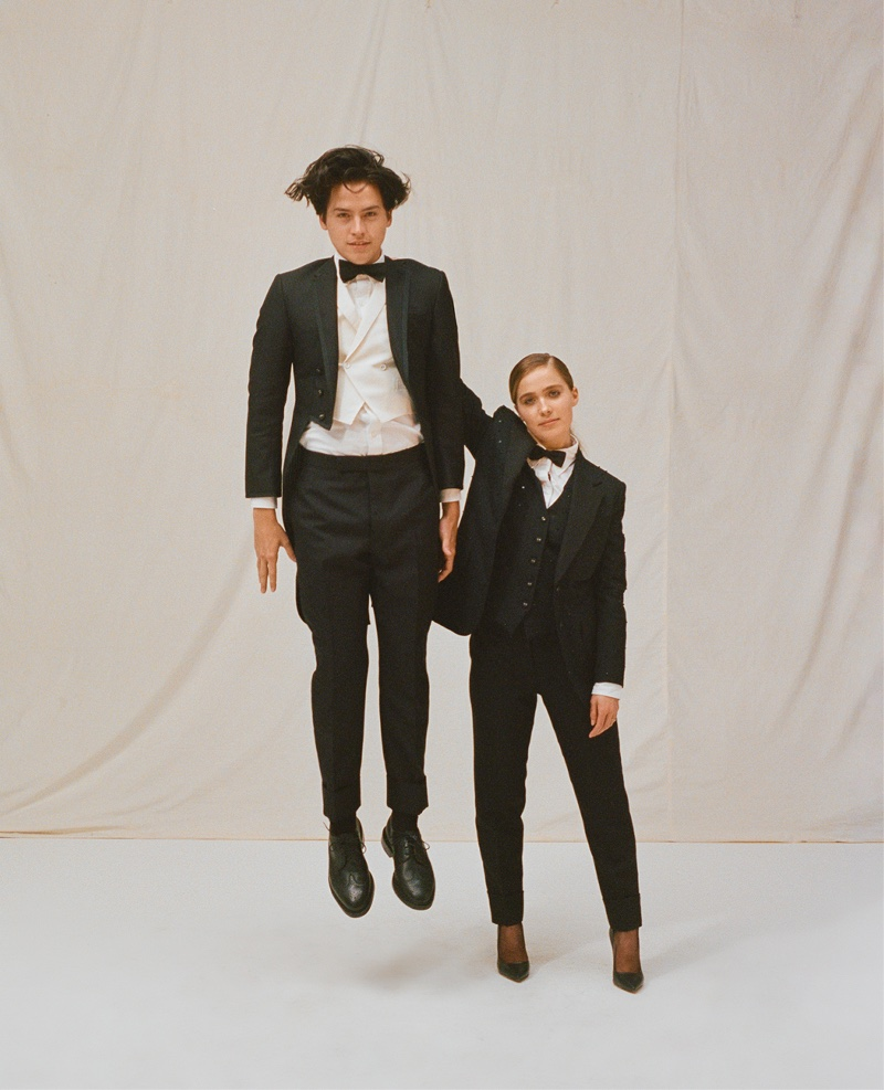 Actors Cole Sprouse and Haley Lu Richardson suit up in black