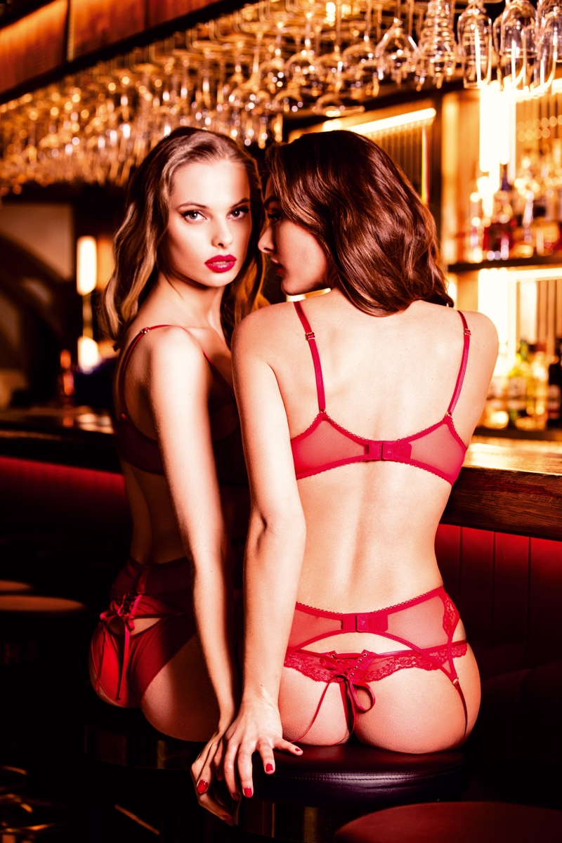 Dioni Tabbers and Charlie Dupont pose at the bar in Honey Birdette lingerie