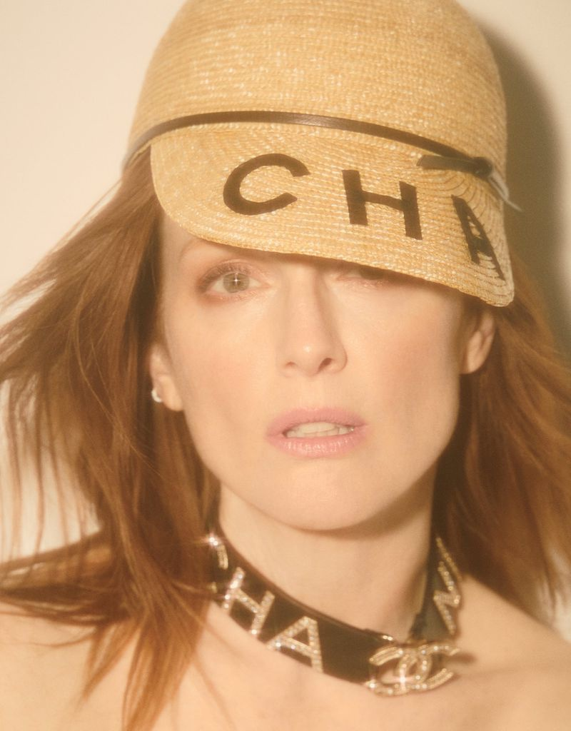 Getting her closeup, Julianne Moore wears Chanel hat and necklace