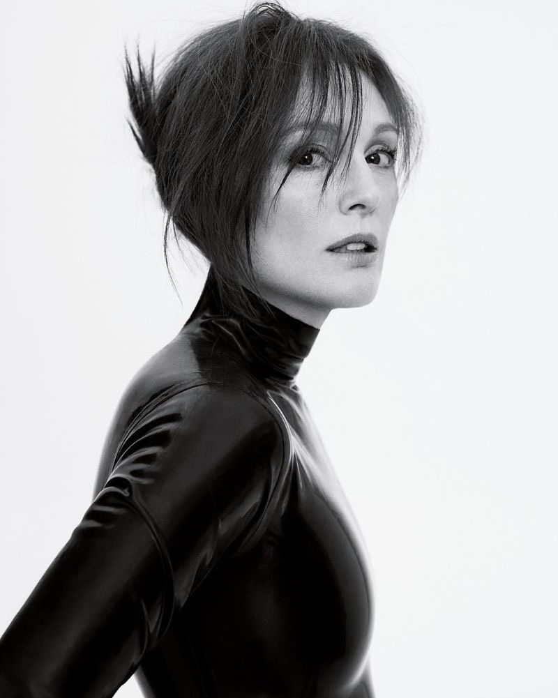 Wearing her hair in an updo, Julianne Moore poses in black and white