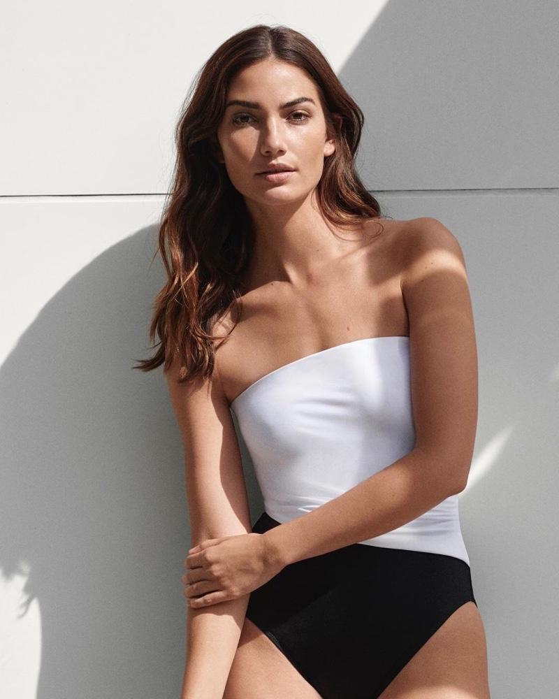 Model Lily Aldridge poses in bandeau swimsuit from Lauren Ralph Lauren spring 2019 collection