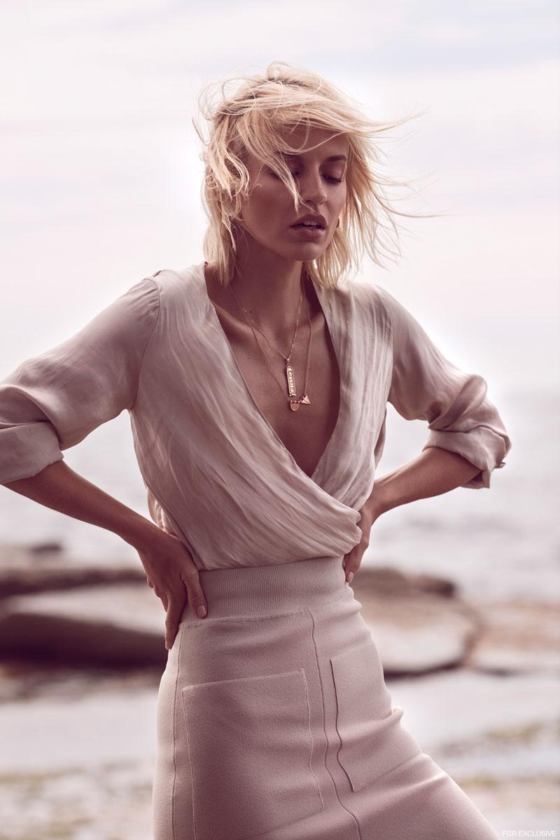 Blouse H&M, Skirt Scanlan & Theodore, Short Necklace model's own, Song Necklace Linda Tahija and Earrings Silverblue. Photo: Milos Mlynarik