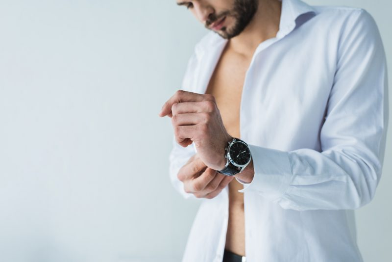 Male Model Putting on Watch