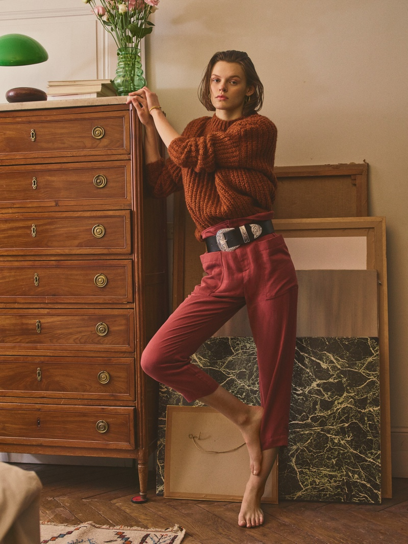 Cara Taylor models knit sweater with high-waisted pants from Mango