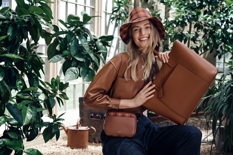 Flashing a smile, Vanessa Axente fronts Oroton fall-winter 2019 campaign