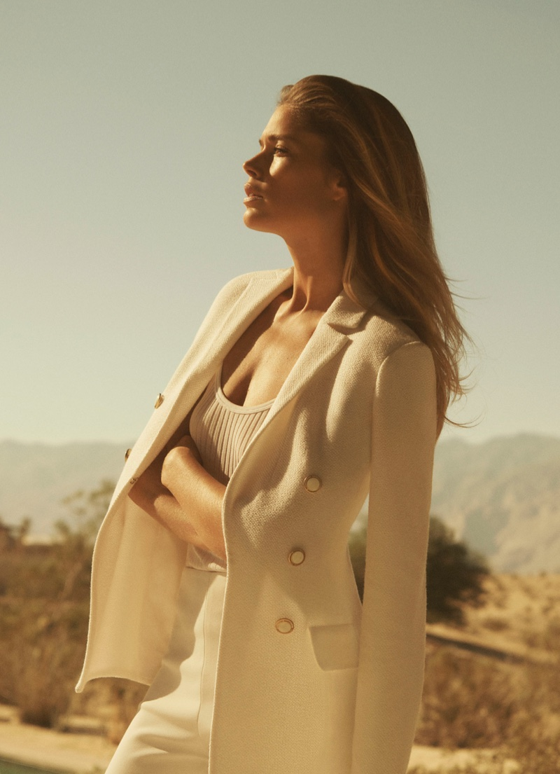 Model Doutzen Kroes wears a blazer in St. John spring 2019 campaign