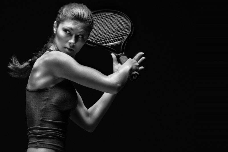 Attractive Woman with Tennis Racket
