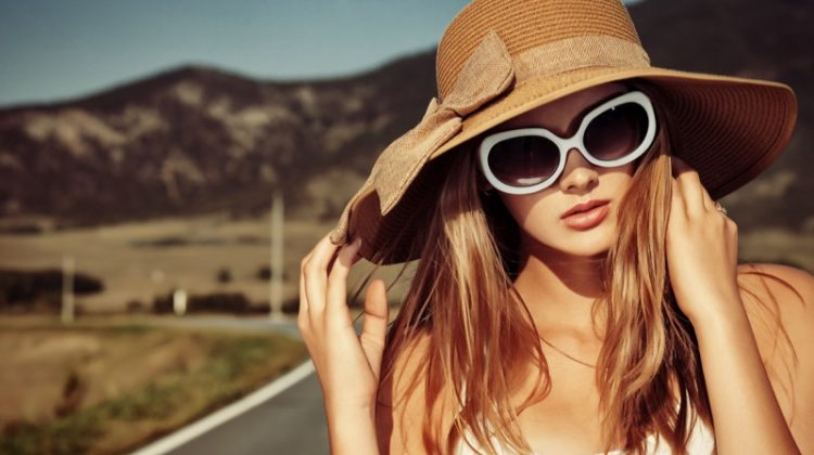 Woman with Hat & Sunglasses on Road