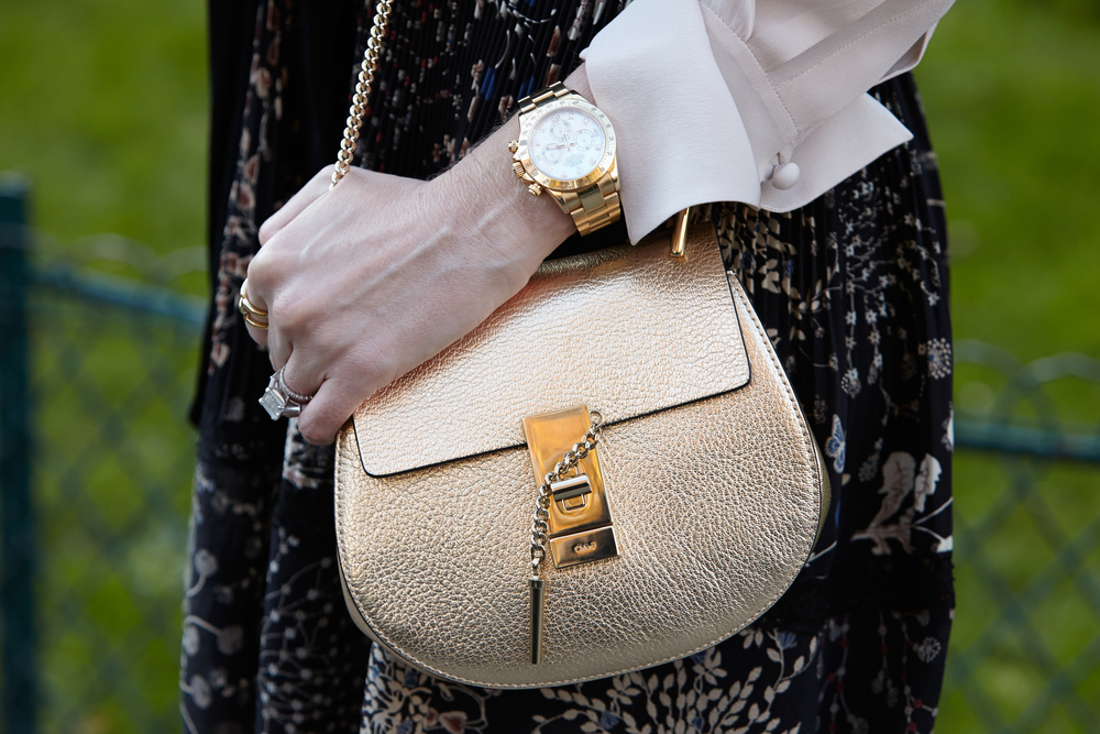 Woman Rolex Chloe Bag