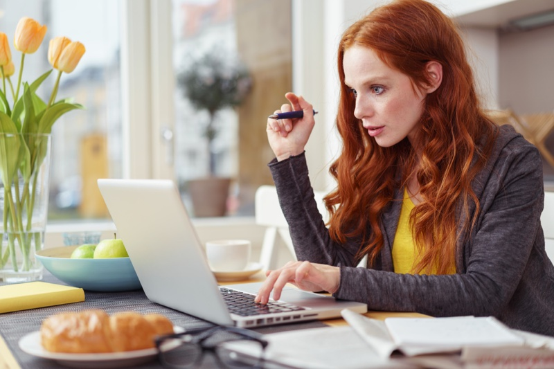 Woman Typing Laptop Red Hair Wearing Hoodie
