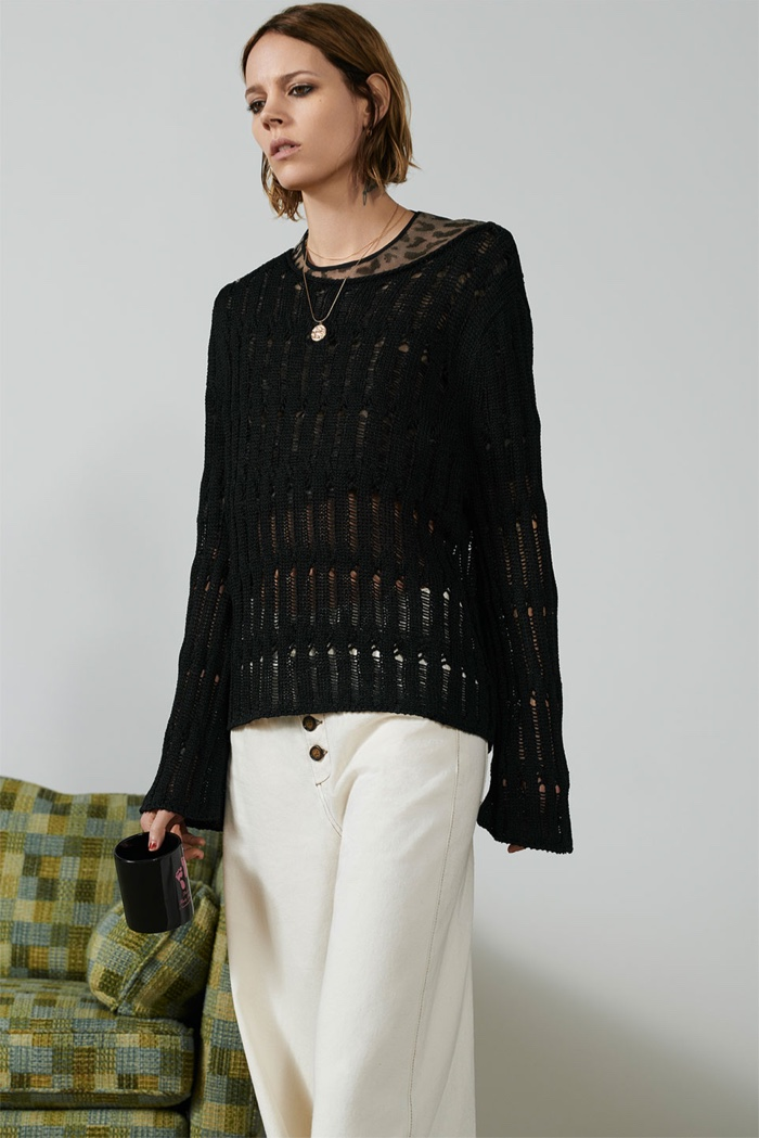 Freja Beha Erichsen poses in Zara open knit sweater and pants with contrasting piping