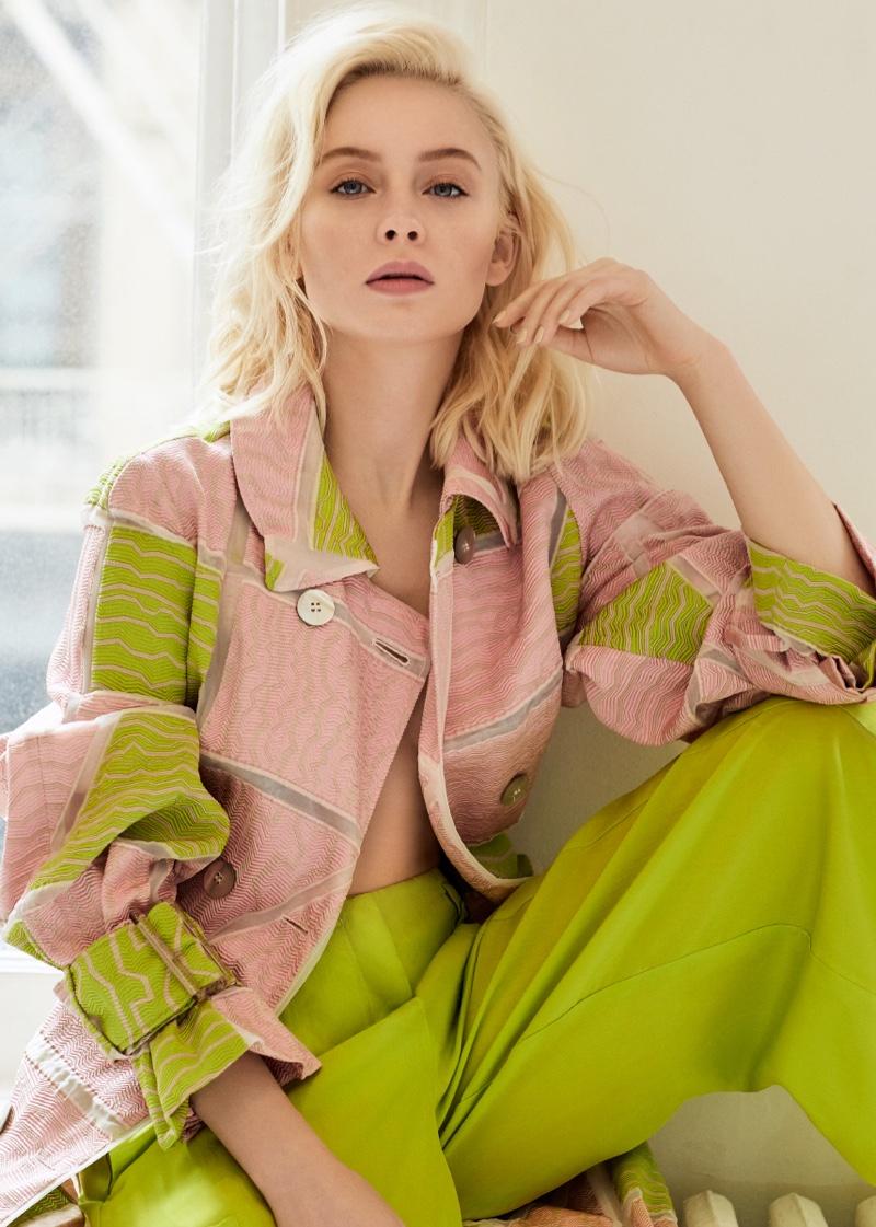 Singer Zara Larsson poses in Emporio Armani jacket and pants