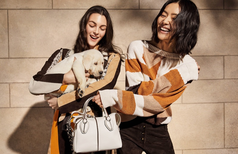 BACKSTAGE: Liu Wen and Vittoria Ceretti pose with a dog on set of Tod's spring 2019 shoot