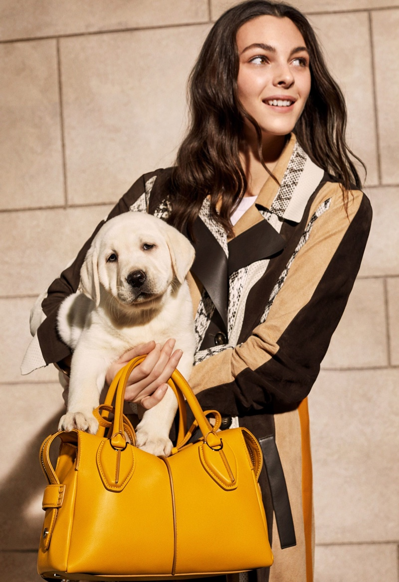 BACKSTAGE: Vittoria Ceretti poses with a dog on set of Tod's spring 2019 shoot