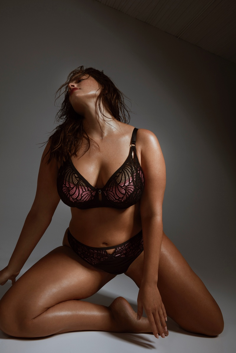 Ashley Graham poses in lace decorated designs from Addition Elle collaboration