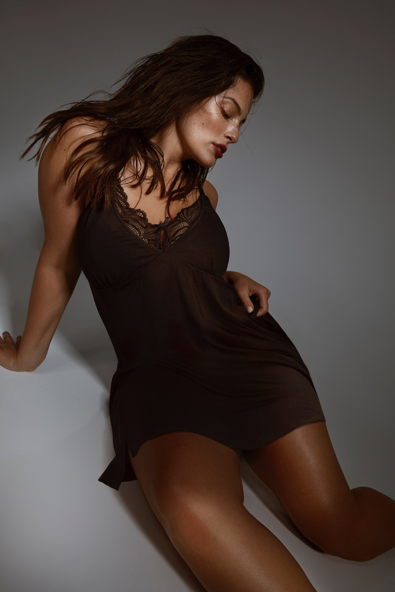 Model Ashley Graham poses in slip dress from Addition Elle collaboration