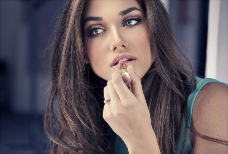 Beautiful Woman Applying Pink Lipstick