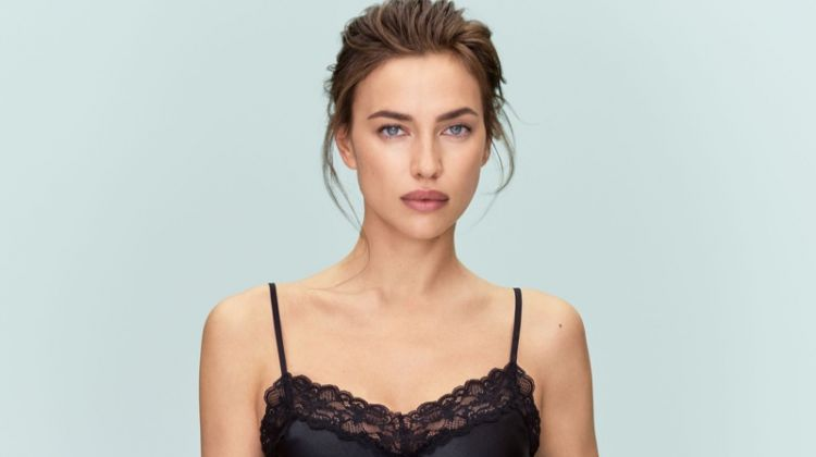 Model Irina Shayk wears lace-trimmed camisole and shorts from Intimissimi Silk collection