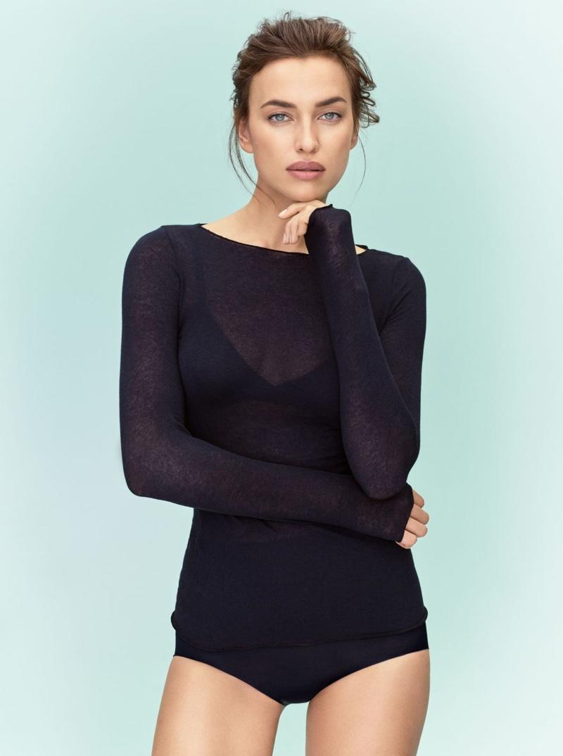 Model Irina Shayk poses in silk top from Intimissimi