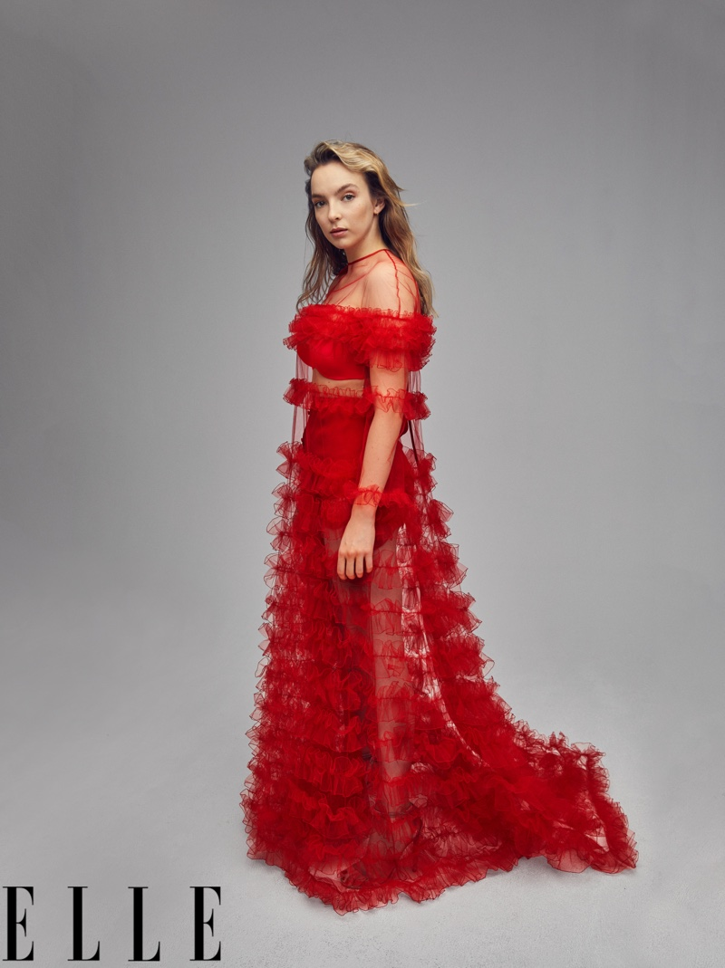 Jodie Comer wears red Valentino gown and shorts with Jimmy Choo sandals