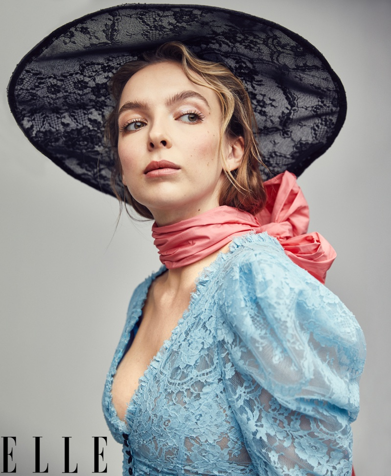 Actress Jodie Comer poses in Erdem dress, hat and scarf