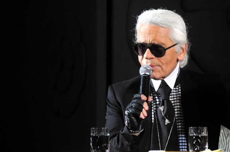 Karl Lagerfeld Holding Microphone