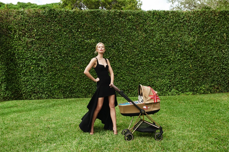 Supermodel Karolina Kurkova poses alongside stroller from Cybex collaboration