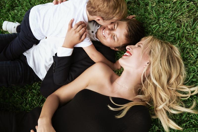 All smiles, Karolina Kurkova poses with her children for Cybex