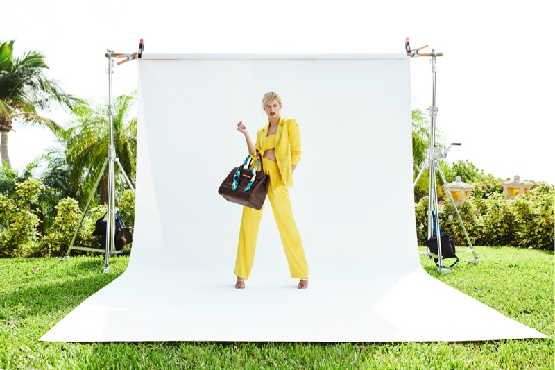 Suiting up, Karolina Kurkova poses with bag from Cybex collaboration