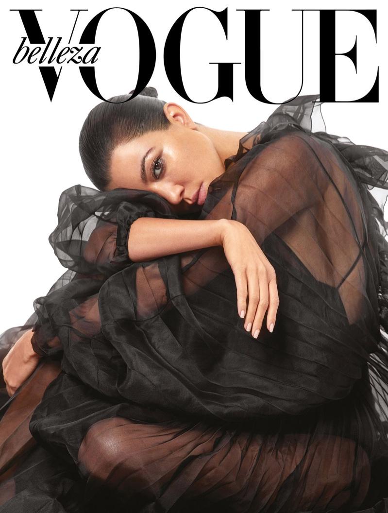 Photographed by An Le, Kourtney Kardashian dresses in black ensemble