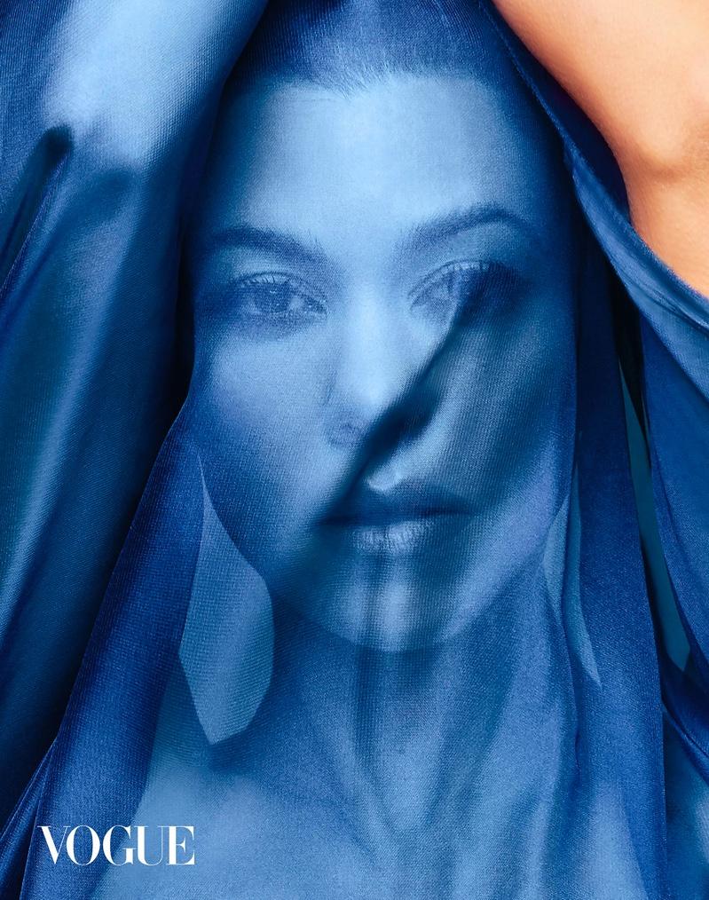 Kourtney Kardashian poses with blue scarf