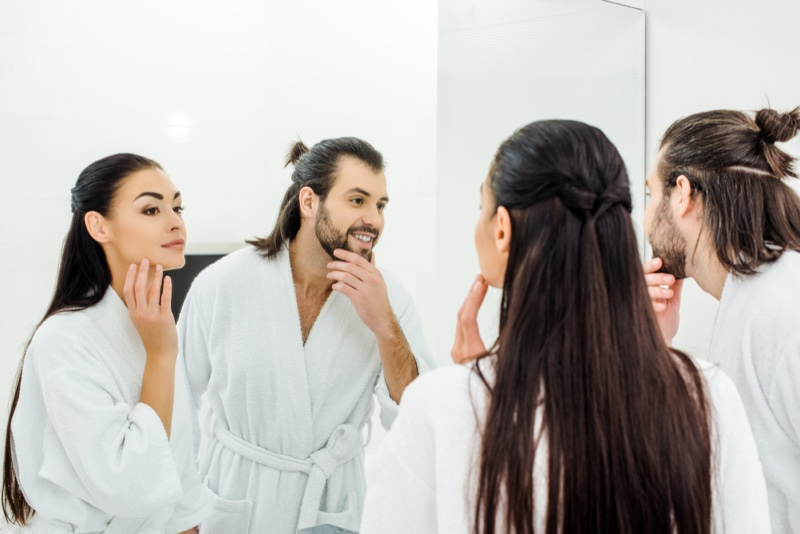Attractive Couple Morning Routine in Mirror
