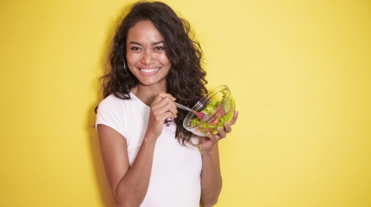 Model Smiling with Salad Wavy Hair White Tee