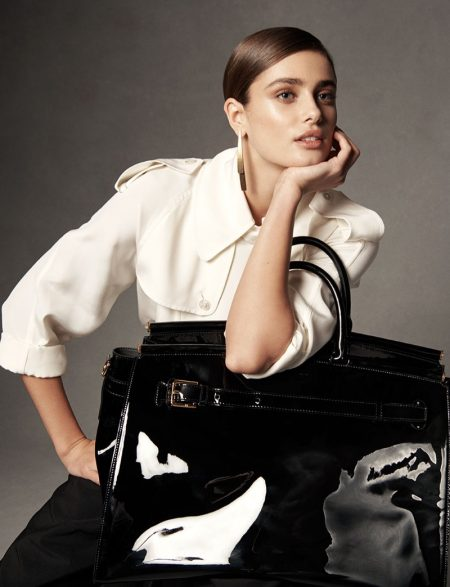 Taylor Hill poses with the RL50 handbag in an oversized silhouette